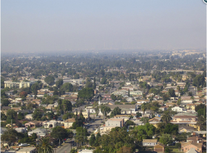 A smog cloud over south Los Angeles, near the city of Compton. A historically African-American and Latino community, Compton is surrounded on all four sides by major highways, and one of its elementary schools sits between a cement plant and a major oil refinery.